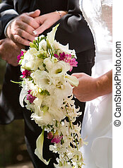 wedding couple - the bouquet of the wedding bride