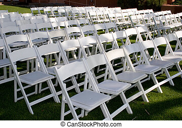 wedding ceremony - chairs are set up for the ceremony