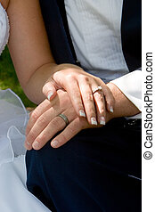 wedding rings - the couple displays the rings