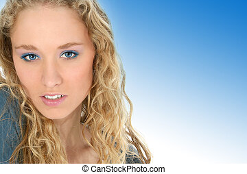 Blue Eyes - Close up of a beautiful young woman with long...