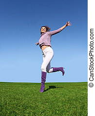 Happiness - Happy woman running on grass
