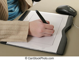 Graphics Tablet Closeup - A closeup of one hand drawing on a...