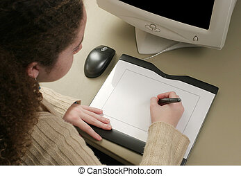 Graphic Artist Tablet - A girl using a graphic tablet to...