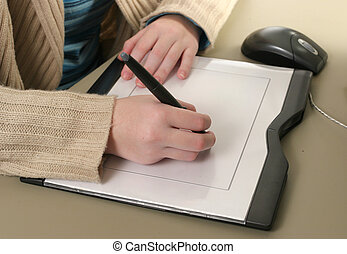 Computer Graphics Tablet - Female hands drawing with the...