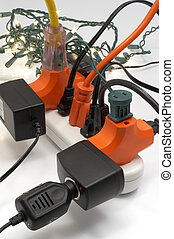Overloaded electrical power strip with Christmas lights in...