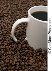 Coffee Beans and Brewed - Cup of coffee in a sea of coffee...