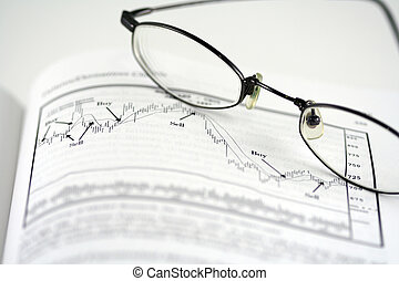 Stock analysis with graph and glasses