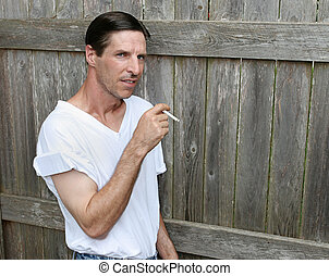 Bored Smoker - Copyspace - A bored looking man smoking a...