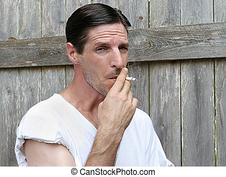 Down & Out Smoker - An unemployed worker smoking outdoors.