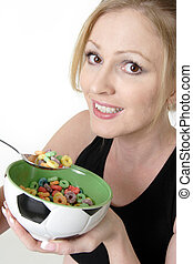 Attractive woman enjoying a bowl of cereal