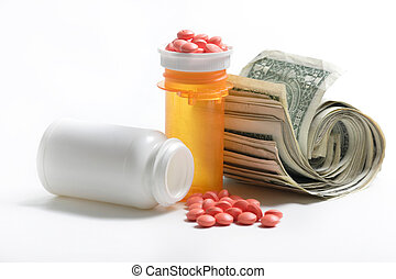 Medication beside a roll of money on white