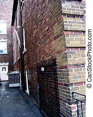 Back alley brick building - Back alley between brick...