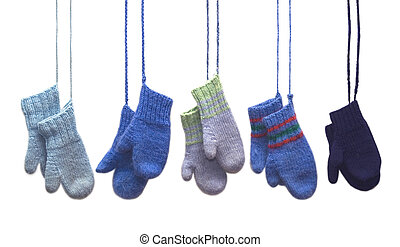 Knitted Mittens - Five pairs of mittens hanging on strings.