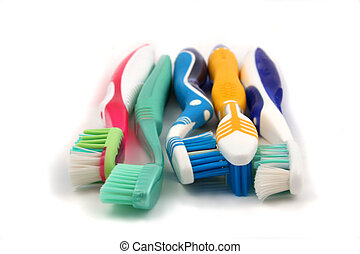 colorful toothbrushes - assorted colorful toothbrushes
