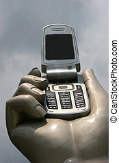 Hand and a cellular phone - Huge hand holding a cellular...