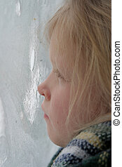 Through the icy wind - A little girl looking through the icy...