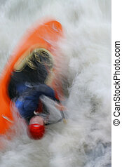 Capsize - A motion blurred shot of a kayaker capsizing in...