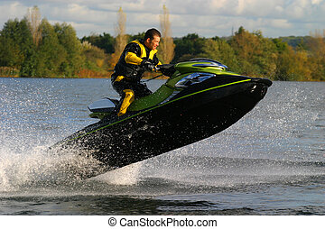 Jet Ski - A jet ski and its rider leap clear of the water