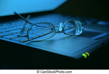 Working late - Spectacles on laptop keyboard, low light