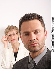 Business couple - Business man and woman portrait, close up