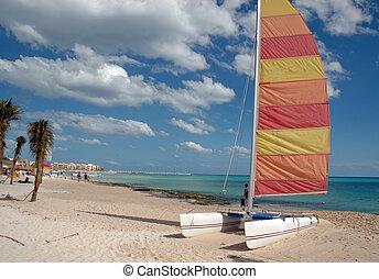 Catamaran at Beach - A catamaran lies empty on a sandy beach...