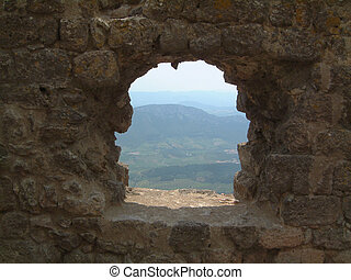 window on Roussillon - View through on a window of Chateau...