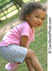 Laughing at You - A young mixed race girl having fun and...