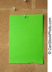 cork board with green sheet