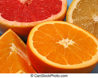 Orange, lemon and grapefruit - Cut orange, lemon and...