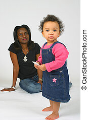 Mother and Daughter - A beautiful mixed race little girl and...