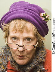 Nanny - Beauitful older woman with a fun expression wearing...