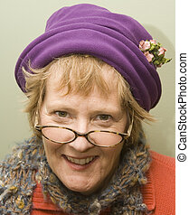 Nanny - Beauitful older woman with purple hat and red...