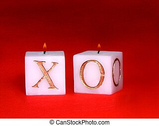 love candles - isolated over red felt lit up xoxo candles
