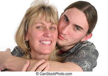 Teen Son Kisses Mom - A teenaged boy kissing his mother on...
