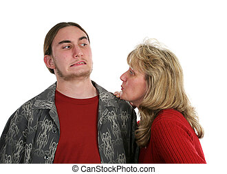 Give Mom A Kiss - A mother trying to give her teen son a...