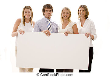 Business Sign - Four business people holding a large blank...