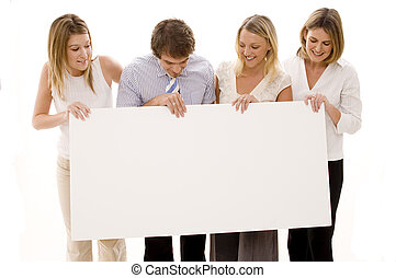 Business Sign - Four young executives holding a big blank...