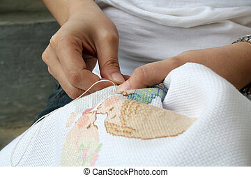 Cross-stitching in the park