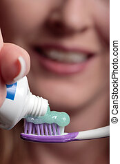 Toothpaste and toothbrush focus on toothpaste and brush