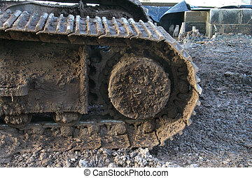 Muddy tracks on construction equipment
