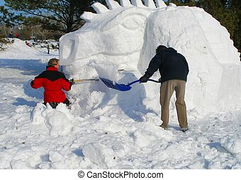 Snow Dragon - Two men building a snow dragon in a park....