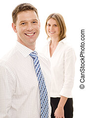 Smiling Businessman - A smiling businessman standing in...