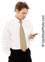 Businessman Texting - A businessman sends a text message on...