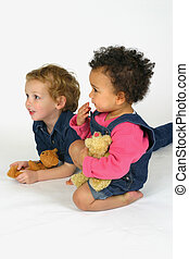 Watching Together - Two young children holding bears and...