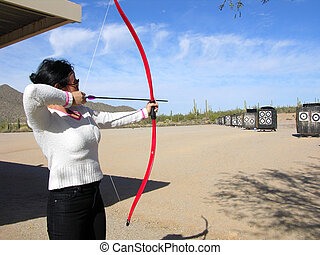 The Lady Archer - Lady at archery range shooting targets