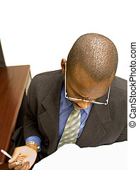 Reviewing Documents - A professional businessman diligently...