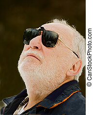 elderly man profile - elderly man with his sunglasses...