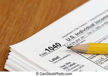 Income Tax - Close view of a pencil and a US tax form 1040