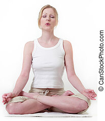 Woman meditating sitting in a yoga position
