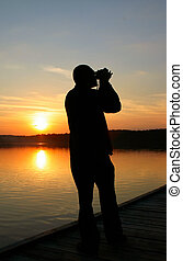 photographer capturing sunset
